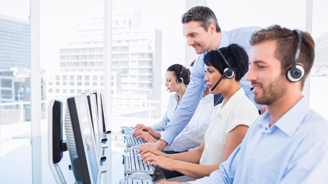 Mitel Cloud Communication Solutions with headsets and formal clothing